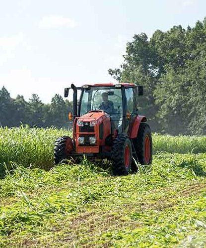 farmer driving a tractor